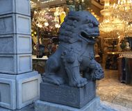 Chinatown`s Dragon Gate, guardian female lion, 2. Often miscalled `Foo Dogs`, the guardian lion originated with the Chinese Buddhist. By Chinese tradition royalty free stock photos