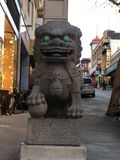 Chinatown`s Dragon Gate, guardian male lion, 6. Often miscalled `Foo Dogs`, the guardian lion originated with the Chinese Buddhist Royalty Free Stock Photo