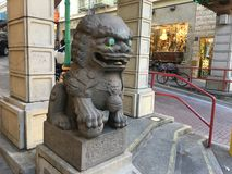 Chinatown`s Dragon Gate, guardian male lion, 5. Often miscalled `Foo Dogs`, the guardian lion originated with the Chinese Buddhist Royalty Free Stock Photography