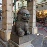 Chinatown`s Dragon Gate, guardian male lion, 1. stock photos