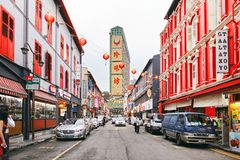 Chinatown, Singapore - March 26, 2013: The Chinese street in Singapore with red splash on buildings with lanterns decoration royalty free stock photos