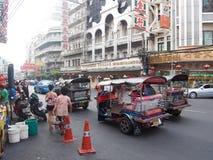 Chinatown street, Bangkok. Tipycal local transport in Chinatown street,Bangkok Royalty Free Stock Photos