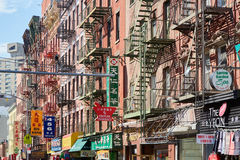 Chinatown street and buildings with stairs and signs in New York Stock Photo