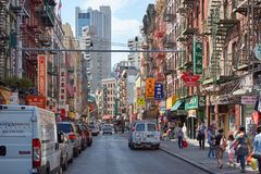 Chinatown street with people and buildings in New York Stock Image