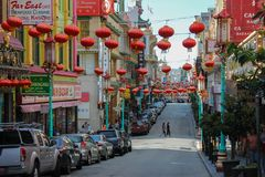 Chinatown streetview in San-Fransisco with cars royalty free stock photography