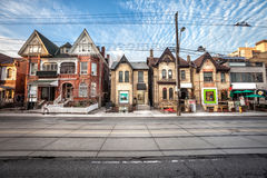 Chinatown in Toronto, Canada. Urban street in the city center of Toronto in Canada. Houses and dwellings in line with activities and shops. Front photo. Blue stock images