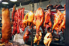 Chinatown Window. Pigs, ducks, chicken, and ribs hang from a window in Chinatown Stock Image