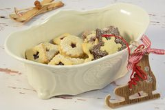 Chinaware with christmas cookies. And ice skate stock photos