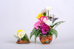 Chinaware with flora. Chinaware with flower white background royalty free stock image