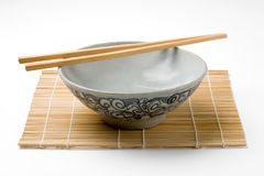 Chinaware, Porcelain,. Bowl old pattern and bamboo Chopstick on white background. Chinaware stock images
