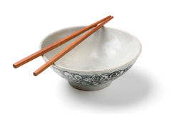 Chinaware, Porcelain,. Bowl old pattern and bamboo Chopstick on white background. Chinaware royalty free stock photography