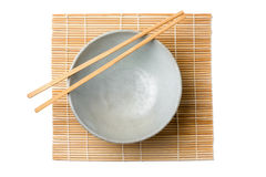 Chinaware, Porcelain,. Bowl old pattern and bamboo Chopstick on white background. Chinaware. Top view of bowl stock photography