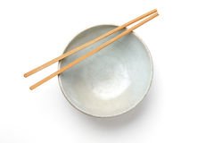Chinaware, Porcelain,. Bowl old pattern and bamboo Chopstick on white background. Chinaware. Top view of bowl stock photo