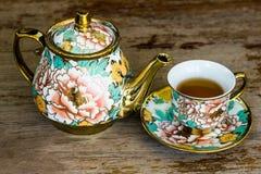 Chinaware tea pod and small drinking bowls Stock Photos