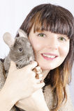Chinchilla with young woman. An chinchilla with an young woman, colour, vertical Stock Image