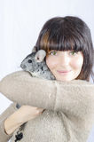 Chinchilla with young woman. An chinchilla with an young woman, colour, vertical Royalty Free Stock Images