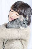 Chinchilla with young woman. An chinchilla with an young woman, colour, vertical Stock Images