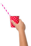 Chinds hand holding red paper cup Royalty Free Stock Photos