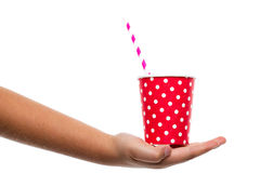 Chinds hand holding red paper cup Royalty Free Stock Images