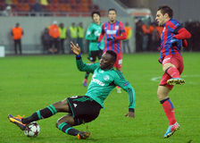 Chinedu Obasi and Adrian Popa during UEFA Champions League game Stock Photo