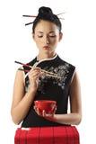 Chinees meisje en oosters voedsel Royalty-vrije Stock Foto