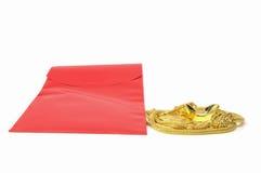 Chinees nieuw jaar, rode zak met goud Royalty-vrije Stock Afbeeldingen
