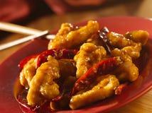 Chinees voedsel - Algemene Tso kip. Stock Afbeeldingen
