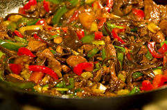 Chineese food. Hot chineese food in wok stock images