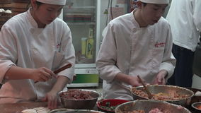 Chines chefs preparing Dim sum dumplings food at Yuyuan Tourist Mart in Shanghai, China. SHANGHAI, CN - MAR 17 2015:Chines chefs preparing Dim sum dumplings food stock video footage