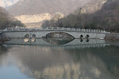 Chines stone arch bridge with reflection Royalty Free Stock Photography