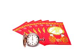 Chinese. Fan shaped chinese money envelopes with pocket watch Stock Image