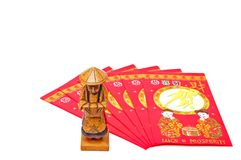 Chinese. Fan shaped lucky money envelopes with figurine over white stock photo