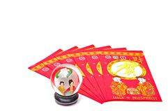 Chinese. Fan shaped lucky money envelopes with colorful glass ball stock images