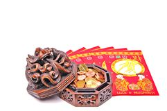 Chinese. Fan shaped chinese lucky money envelopes with ceramic vessel full of coins stock photo