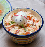 Chinese 2008 New Year symbolic mouse made from egg. And radish at the top of served salad Royalty Free Stock Photo