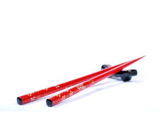 Chinese. Red chopstick at white background Stock Images