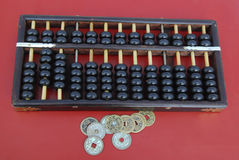 Chinese abacus with antique Chinese coins Royalty Free Stock Images