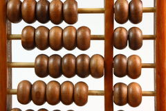 Chinese Abacus Close Up. A close up photo of a wooden Chinese abacus in front of a white background Stock Images