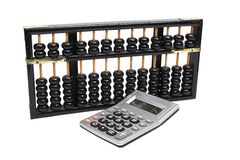 Chinese abacus and electronic calculator Stock Images