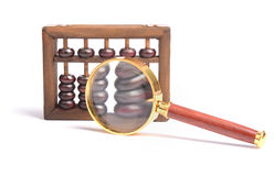 Chinese abacus and Magnifying glass Royalty Free Stock Photo