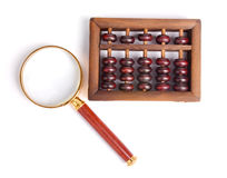 Chinese abacus and Magnifying glass Stock Photo