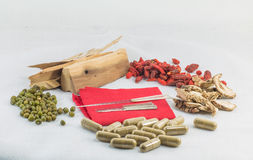 Chinese acupuncture needles on red cloth with chinese herb and c Royalty Free Stock Photo