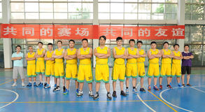 A Chinese amateur basketball team. Before the game, a China amateur basketball team in Jiangxi province. Filmed in August 30, 2014 stock photography