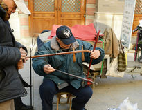 Chinese amateur musician. An Chinese amateur musician is selecting an instrument photoed at culture street Tianjin China on february 4th 2014 Stock Images