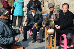 Chinese amateur musician  in park. Chinese amateur musician  enjoying themselves  in park photoed in xigu park Tianjin China on March 9th 2014 Royalty Free Stock Photography