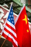 Chinese and American flags together outside Stock Photos
