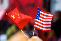 Chinese and American flags together outside Royalty Free Stock Photo