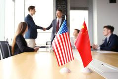 Chinese and American leaders shaking hands on a deal agreement. Chinese and American leaders shaking hands on a deal agreement Royalty Free Stock Image