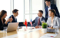Chinese and American leaders shaking hands on a deal agreement. Chinese and American leaders shaking hands on a deal agreement Royalty Free Stock Photography