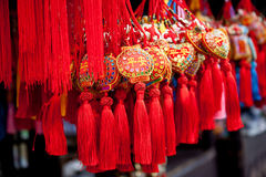 Chinese amulets as souvenirs. Red chinese amulets with embroidery as souvenirs Stock Photography